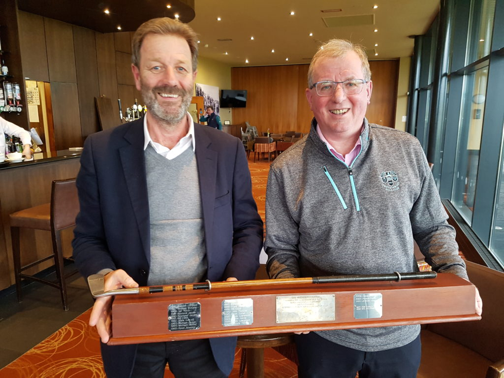 Liam Kelly storms home with 14 Stableford Points over his closing five holes to capture the AGWs President Putter with AGW Golf Captain, Peter Dixon (l) presenting the trophy.
