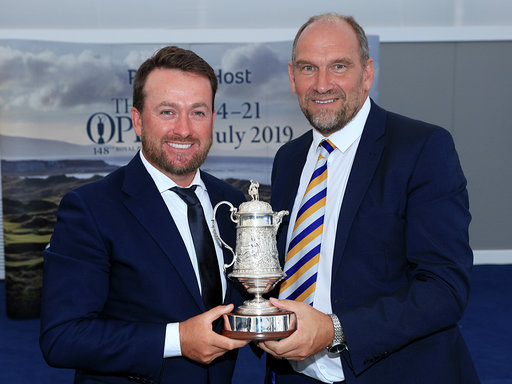 PORTRUSH, NORTHERN IRELAND - JULY 16: Graeme McDowell of Northern Ireland receives the Arnold Palmer AGW Open Award from Martin Dempster the chairman of the Association of Golf Writers during the Association of Golf Writers Annual Dinner and Awards at Royal Portrush Golf Club on July 16, 2019 in Portrush, Northern Ireland. (Photo by David Cannon/Getty Images)
